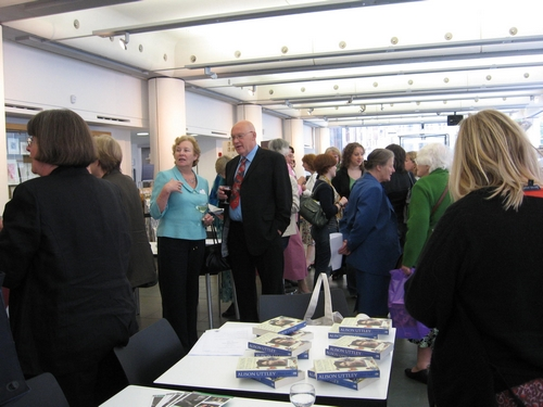Guests at the launch, where copies of the book were on sale.
